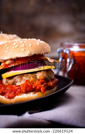 Mini beef burger stuffed with ajvar salad,selective focus  - stock photo