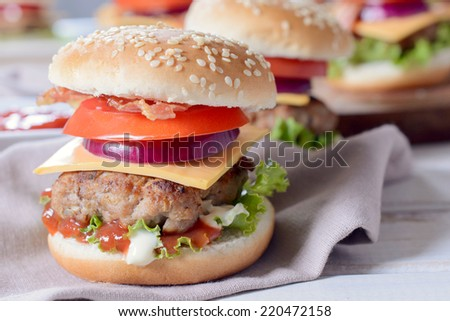 Mini beef burger with vegetables and cheese,selective focus - stock photo
