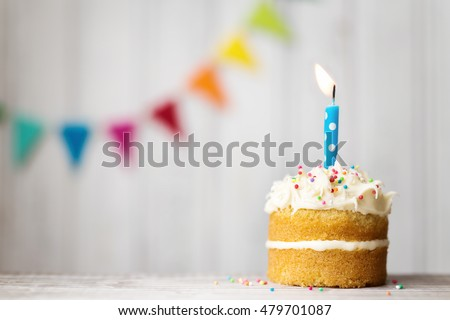 Mini birthday cake with a single candle