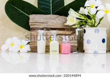 mini bubble bath and shower set  decorated with flower - stock photo