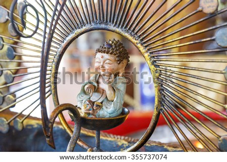 Mini Buddha statue in circle of decoration in temple, Bangkok, Thailand.