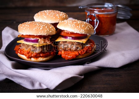 Mini burgers stuffed with vegetables and ajvar salad,selective focus  - stock photo