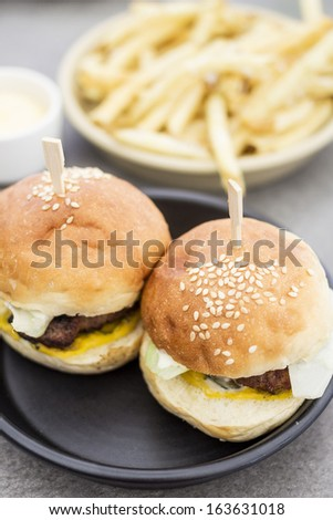 Mini burgers with fries and aioli - stock photo