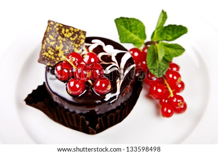 Mini cake with chocolate, mint and berries on white background - stock photo