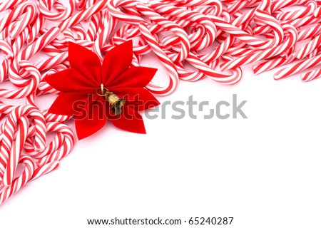 Mini candy canes making a border on a white background, Christmas Time - stock photo