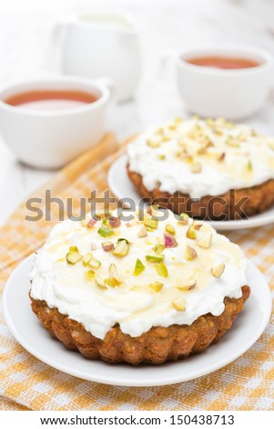 mini carrot cakes with cream of mascarpone and honey on the plate, vertical