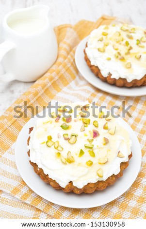 mini carrot cakes with cream of mascarpone and honey, top view, vertical - stock photo