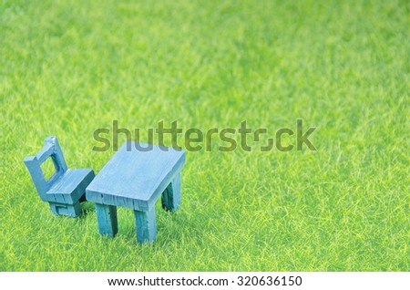 mini chair and table on a grass - stock photo