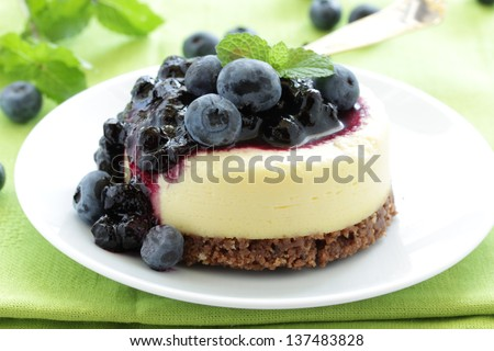 Mini-cheesecake and chocolate biscuits and bilberry. - stock photo