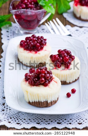 Mini cheesecake with cranberries - stock photo