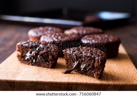 Mini Chocolate Cake Souffle on wooden surface.