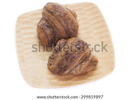 Mini chocolate croissant isolated on white background
