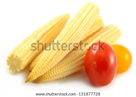 Mini corn and cherry tomatoes on a white background - stock photo