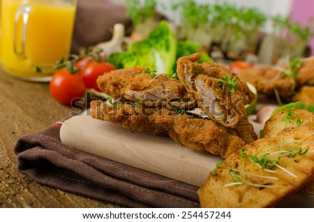 Mini cutlets - schnitzels of chicken legs meat and fresh salad and toasted baguette - stock photo