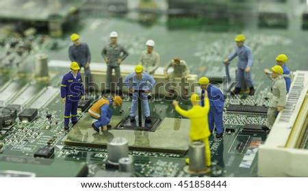 mini engineer team are repairing chip-set on mainboard - can use to display or montage on products - stock photo