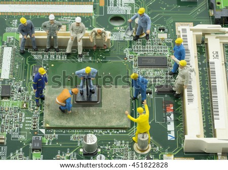 mini engineer team to repair chip-set on green mainboard - can use to display or montage on product or concept of job response - stock photo