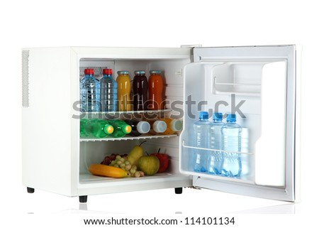 mini fridge full of bottles of juice, soda and fruit isolated on white