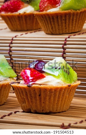 Mini fruit tart and wooden background