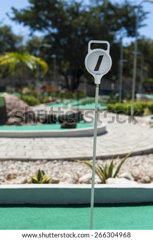 Mini Golf hole #1 on an outdoor course in the summer - stock photo