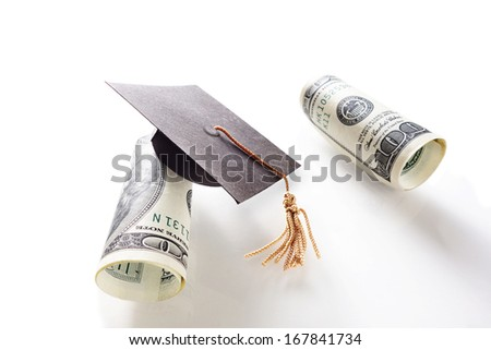 mini graduation cap and hundred dollar bills                              - stock photo
