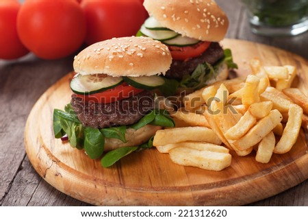 Mini hamburgers served with french fries, classic fast food - stock photo