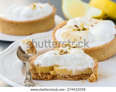 Mini lemon meringue pie. Lemon tart. Lemon tartlets. - stock photo