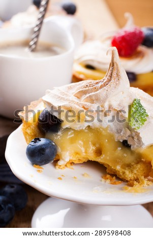 Mini lime curd tartlets with meringue. Holiday concept.  Selective focus. - stock photo