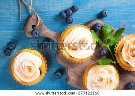 Mini lime curd tartlets with meringue. Holiday concept. Top view. - stock photo