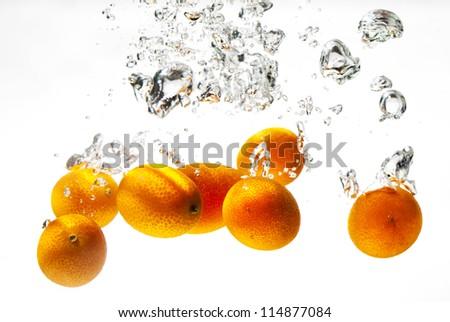 Mini oranges or kumquats - stock photo