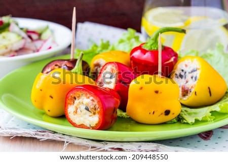 Mini pepper, capsicum, paprika stuffed with cream cheese on grill, delicious appetizer picnic - stock photo
