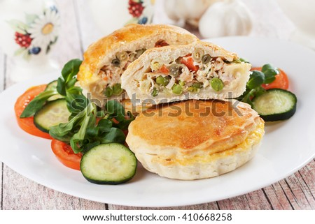 Mini pie filled with chicken meat and vegetables - stock photo
