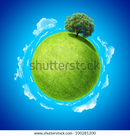 Mini planet concept. Empty space on fresh green field and sole standing dense tree. Place for your text, product or logo. Earth collection. - stock photo