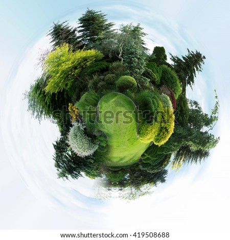 mini planet of Beautiful spring garden design, with conifer trees, green grass. Beautiful Little planet with spring garden, ecology concept. Tiny green planet with trees - stock photo