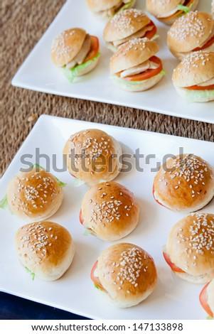 Mini Pork burger on white plate - stock photo