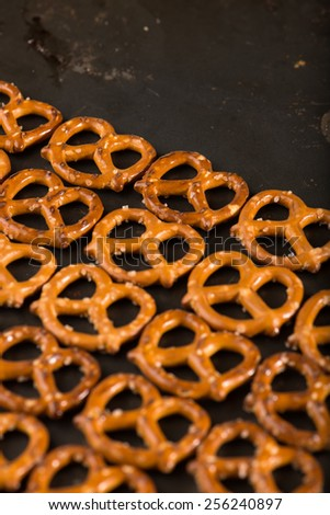 mini pretzels in a cooking pan, close up, vertical