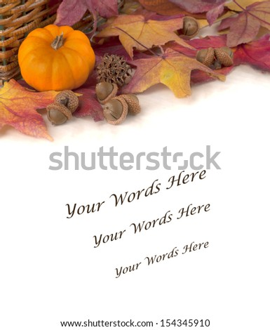 Mini Pumpkin with Colorful Fall Leaves and Acorns on a Table with Background Space or Room for your Text  - stock photo