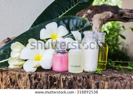 mini set of bubble bath and shower with natural background - stock photo