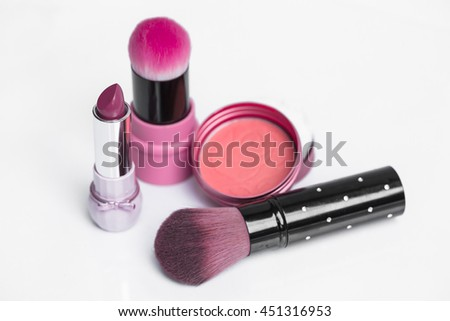 Mini set of pink tone makeup and cosmetics on white background