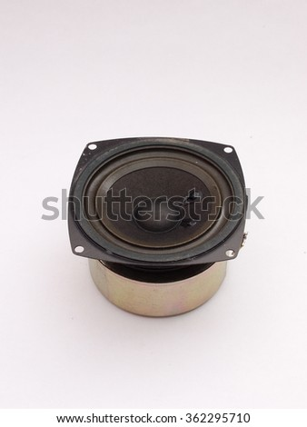 mini size full range paper cone loudspeaker driver with rubber edge, and small voice coil huge magnet for use with high watts amplifier suitable for compact style book shelf hi-fi home system  - stock photo