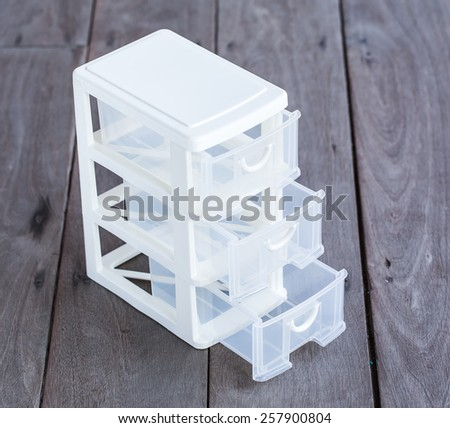 mini storage plastic box for office on wood background - stock photo