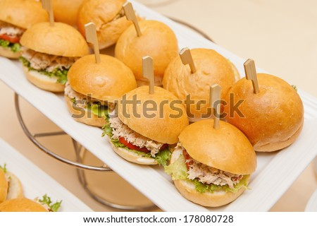 Mini Tuna Burgers with toothpick for party - stock photo