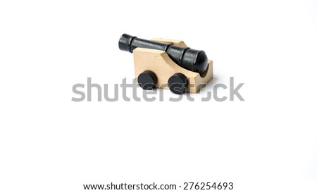 Mini vintage fortress wooden cannon. Concept of small yet powerful weapon. Isolated on white background. Copy space.