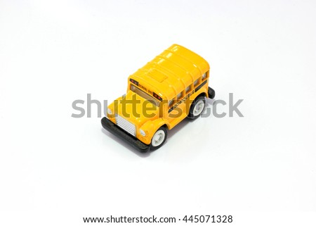 Mini vintage yellow school bus metal toy isolated on a white background, represent every children were safe to go to school when they arrived to this bus on time. - stock photo