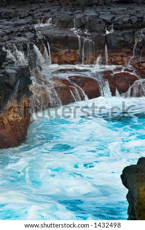Mini waterfalls on Kauai on Kauai Hawaii. More with keyword Series001C. - stock photo