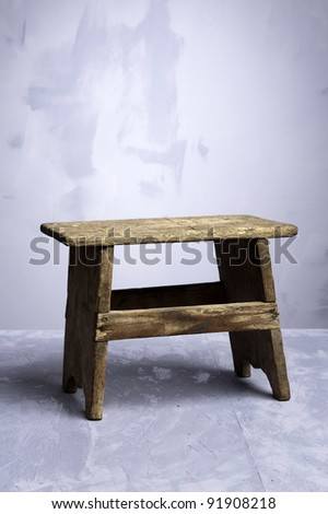 Mini Wood Stool over a blue background - stock photo