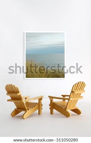 Miniature adirondack chairs on white - stock photo