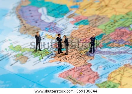 Miniature business people on map of Europe. Macro photo - stock photo