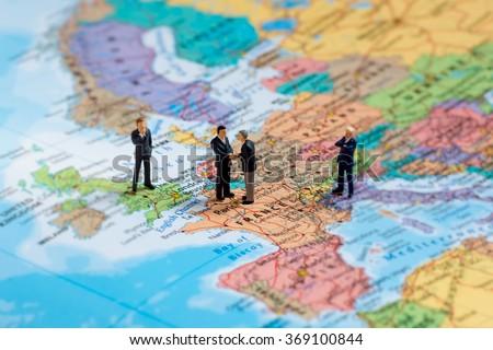 Miniature business people on map of Europe. Macro photo - stock photo