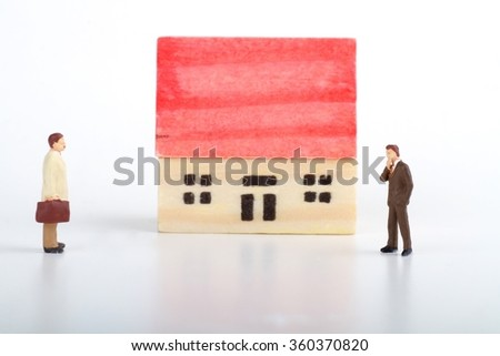 miniature concept of real estate negotiation - stock photo