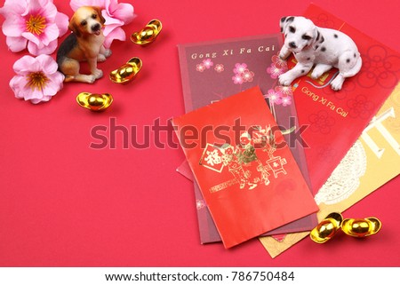 Miniature dogs with chinese new year decorations for year 2018.